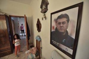 A poster of Ahed Zaqout is displayed in the apartment rented by his surviving family.