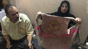 Razan's mother, Sabreen Najjar showed the vest worn by Razan when she was shot. Beside her was Razan's father, Ashraf Najjar.